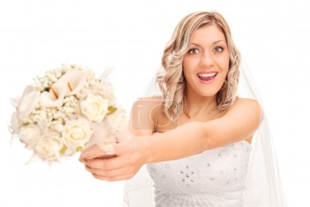 Excited bride preparing to toss the flowers