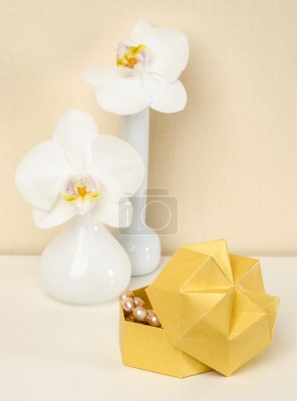 Box Origami vase with orchids