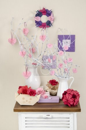 Photo for Decorations for the house origami roses heart on the branches in vases - Royalty Free Image