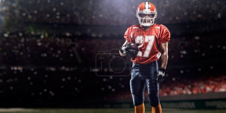 Photo for American football player in action on the stadium - Royalty Free Image