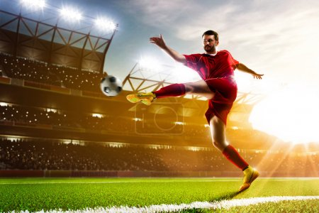 Photo for Soccer player in action on night stadium background - Royalty Free Image