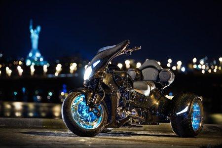 Black trike standing on the night street
