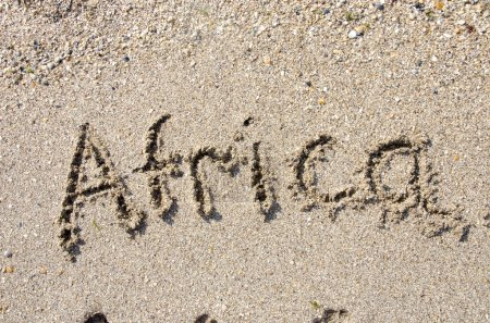 Photo for The word Africa handwritten in sand on a beach, ideal for internet or conceptual designs background with feet metaphor for communication, speech, message, mail, dialog, talk, contact, email, internet - Royalty Free Image