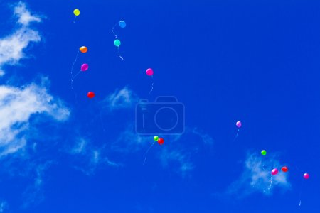 Colourful balloons high in the sky