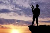 Silhouette of soldier with a gun