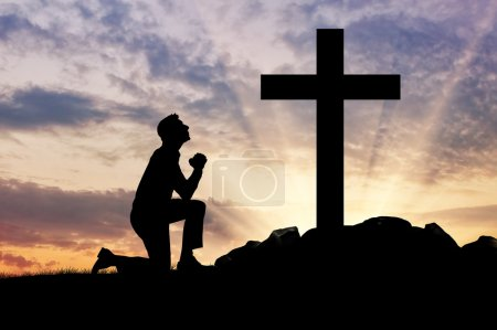 Silhouette of man praying