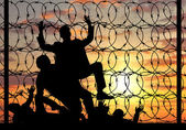 Silhouette of refugees crossing the border illegally