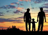 Silhouette of gay parents with a child