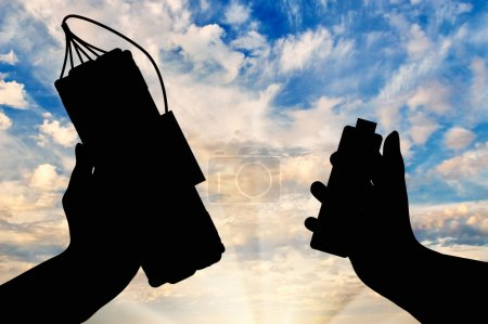 Silhouette  a bomb with a detonator in hands