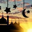 Concept of the Islamic religion. Silhouette of the town hall at sunset in the rays of light