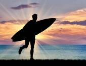Silhouette of a surfer on the beach