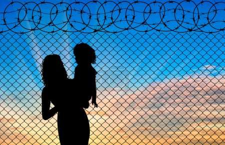 Silhouette of mother and child refugees
