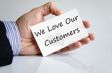 Photo for Business hand writing text We love our customers - Royalty Free Image