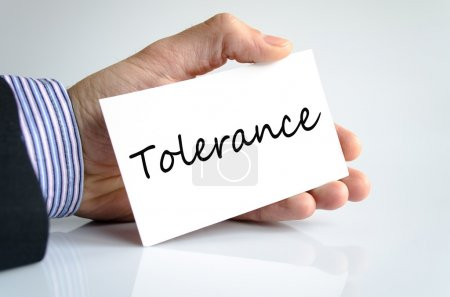 Tolerance concept note in business man han...
