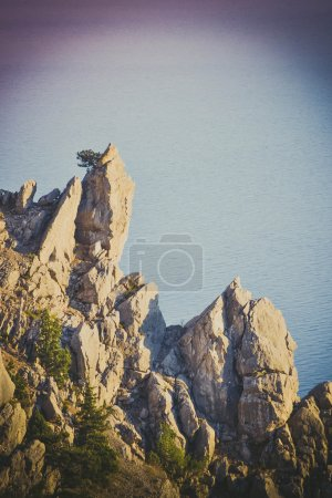 stone rock on sea background