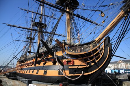 Photo for HMS Victory was Admiral Horatio Nelson's flagship at the Battle of Trafalgar in 1805 during the Napoleonic Wars. She is currently in a dry dock at Portsmouth, England serving as a major tourist attraction for the city - Royalty Free Image