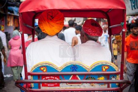 HARIDWAR, INDIA - AUG 9 - A bicycle rickshaw rides...