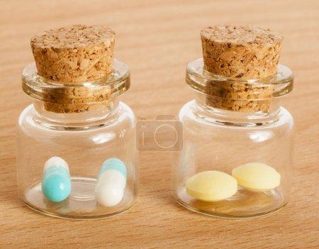 pills in glass jars