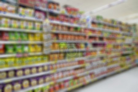 Photo for Blurred supermarket background and unidentified people who are shopping - Royalty Free Image