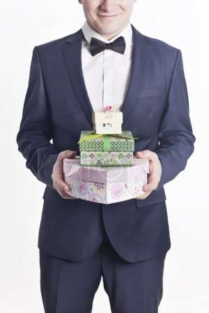 Business man with gifts (vertical image)