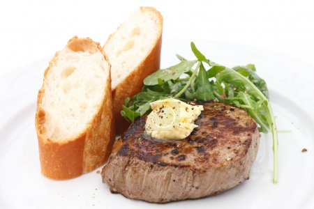 Photo for Perfect roast pork tenderloin fillet steak topped with melting butter. - Royalty Free Image