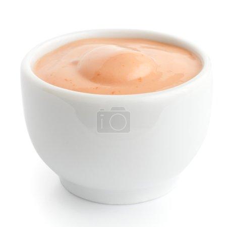 Small white ceramic dish of American mustard.
