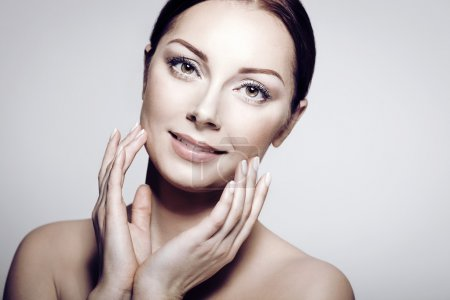 Photo for Beauty Portrait. Beautiful Spa Woman Touching her Face. Perfect Fresh Skin. Pure Beautiful Model Girl. Youth and Skin Care Concept . - Royalty Free Image