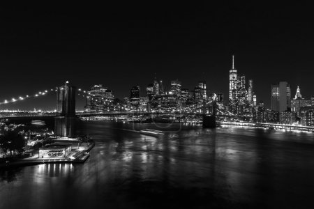 black and white picture of the skyline of Manhattan, NYC at night