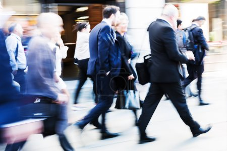 Photo for Picture in motion blur of walking commuters at rush hour - Royalty Free Image