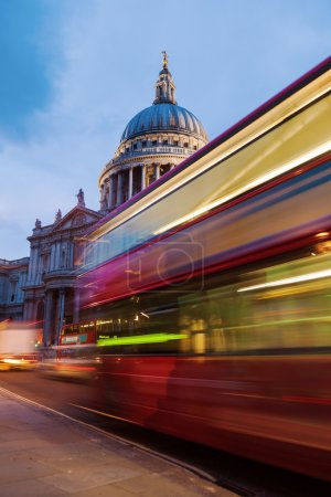 St. Pauls Cathedral in London, UK, with light trails of a London Bus