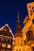 Old buildings and church in the old town of Riga, Latvia, at night