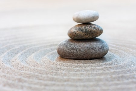 Photo for Stack of pebbles in a Zen style garden - Royalty Free Image