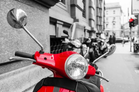 Red scooter with black and white surrounding