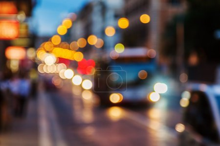 Intentional out of focus picture of a city scene at night with traffic lights