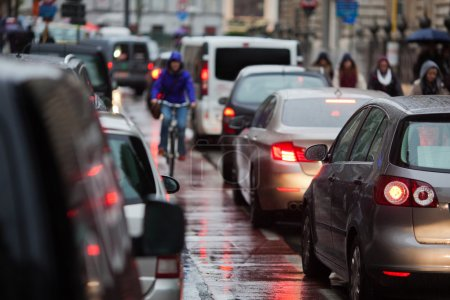 Photo for Cars in a traffic jam at rush hour in the rainy city - Royalty Free Image