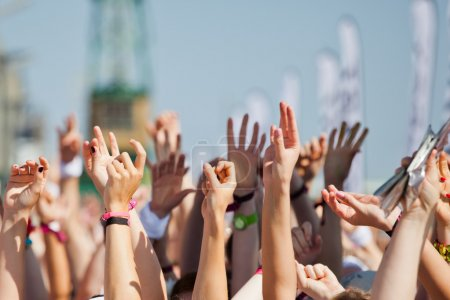 Raised hands of a crowd of people at a sport event