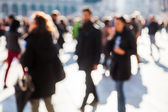 Crowd of people on a city square out of focus