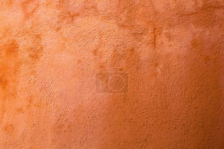 Background texture of a terracotta colored wall