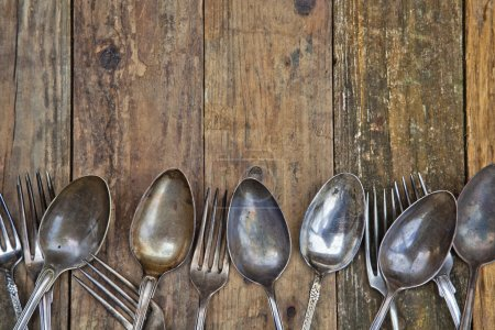 Photo for Background from old wood panels with a border of antique cutlery - Royalty Free Image