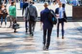 Business people on the move in motion blur