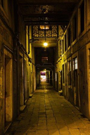 Dark alley in Venice, Italy, at night