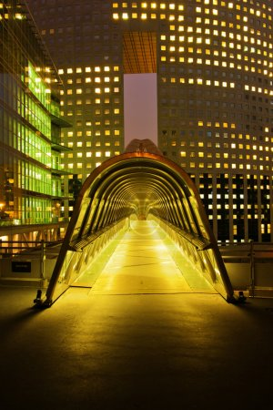 Roofed footbridge at night in the financial district La Defense in Paris, France