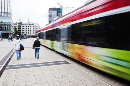 Street view of the financial district in Frankfurt, Germany, with tram and people in motion blur