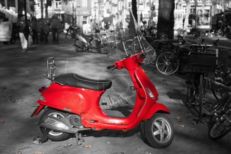 Red scooter with a black and white surrounding
