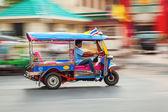 Traditional tuk tuk in Bangkok, Thailand, in motion blur