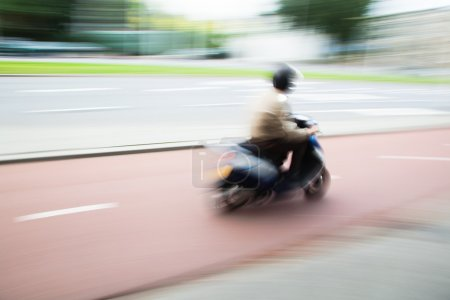 Photo for Scooterist in motion blur - Royalty Free Image
