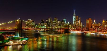 East River and skyline of Manhattan, NYC, at night