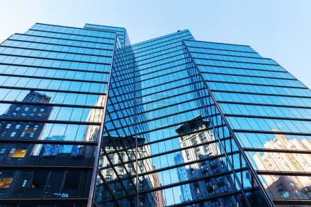 Glass towers with reflections in NYC