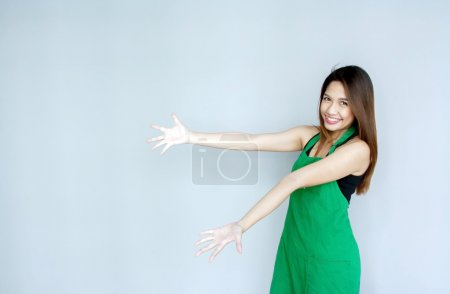 asian girl action with green apron suite