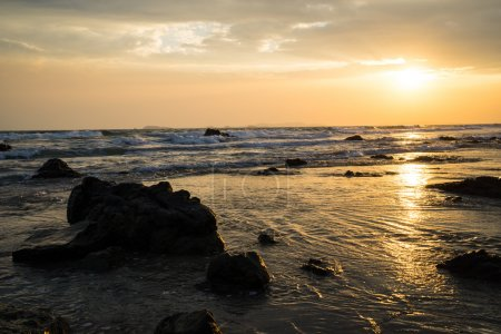 Summer sunset at the rocky beach in front of 6-star beach front hotel for a perfect hide away holidays alone or even better with family who can enjoy outdoor activities, seafood and unforgettable stay